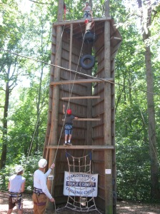 "NBS students climb the ""Vertical Playpen"" at Triple C's Challenge Course."