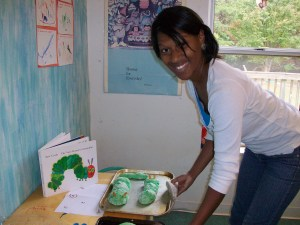 Nursery teacher shows off the caterpillar-green bread made by the preschool students.