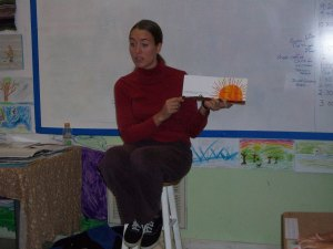 Nursery teacher Kyla Saby reads this year's book in Spanish with the Juniors.