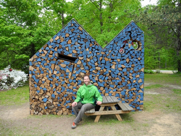 Heath Matysek-Snyder in front of the wood art installation
